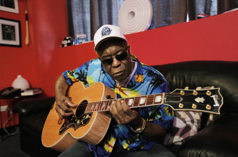 In this Aug. 3, 2012 photo, blues great Buddy Guy is seen during an interview with the Associated Press at his club Buddy Guy's Legends in Chicago's South Loop. (AP Photo/M. Spencer Green)