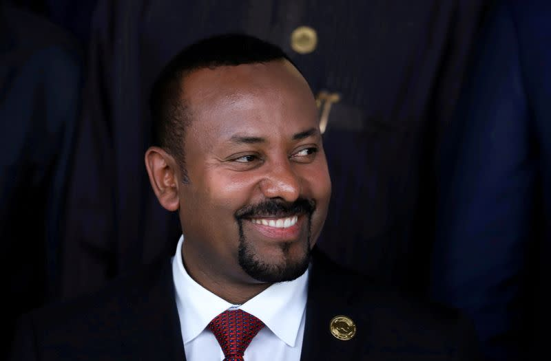 FILE PHOTO: Ethiopia's Prime Minister Abiy Ahmed poses for a photograph during the opening of the 33rd Ordinary Session of the Assembly of the Heads of State and the Government of the African Union (AU) in Addis Ababa