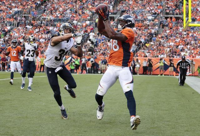 Denver Broncos wide receiver Demaryius Thomas (88) catches a pass for a touchdown against St. Louis Rams cornerback Cortland Finnegan (31) in the first quarter of a preseason NFL football game, Saturday, Aug. 24, 2013, in Denver. (AP Photo/Joe Mahoney)
