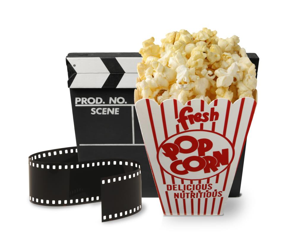 A box of popcorn,a movie slate, and film clip representing the film and movie industry