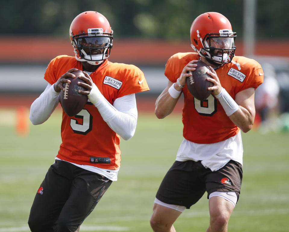 FILE - In this Aug. 27, 2018, file photo, Cleveland Browns quarterbacks Tyrod Taylor (5) and Baker Mayfield (6) throw during NFL football practice in Berea, Ohio. When Cleveland fans fill FirstEnergy Stadium on Sunday for the first time in nearly two years, they'll see several familiar faces on Houston's roster, including Taylor, who was briefly the Browns' starter when Mayfield was a rookie in 2018. (AP Photo/Ron Schwane)