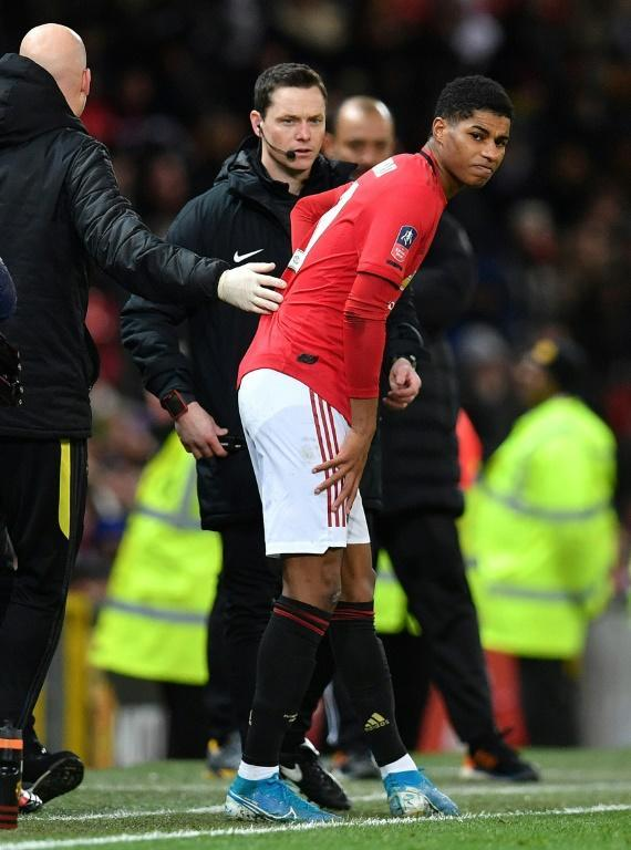 Manchester United striker Marcus Rashford will be out of action for three months to recover from a double stress fracture to his back (AFP Photo/Paul ELLIS)