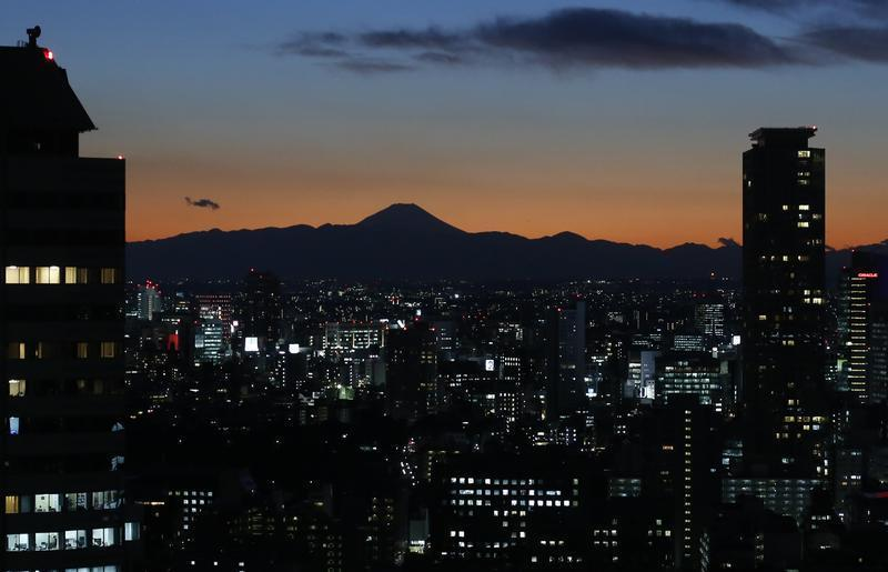 The silhouette of Japan's highest Mt. Fuji is seen beyond buildings in Tokyo