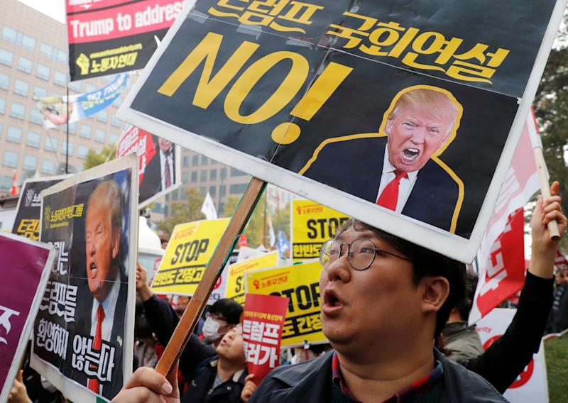 Protesters gather near the South Korean National Assembly in Seoul, where Trump spoke in November. (Kim Kyung Hoon / Reuters)