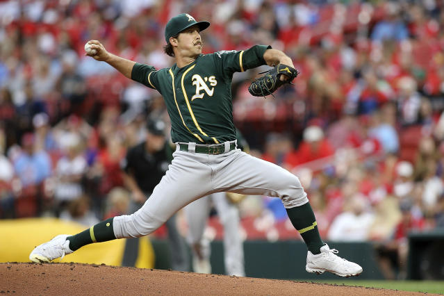 Oakland Athletics starting pitcher Daniel Mengden (33) delivers during the first inning of a baseball game against the St. Louis Cardinals Wednesday, June 26, 2019, in St. Louis. (AP Photo/Scott Kane)