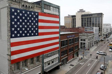 The U.S. flag decorates a building in downtown Memphis, Tennessee, U.S., March 27, 2018.  REUTERS/Jonathan Ernst