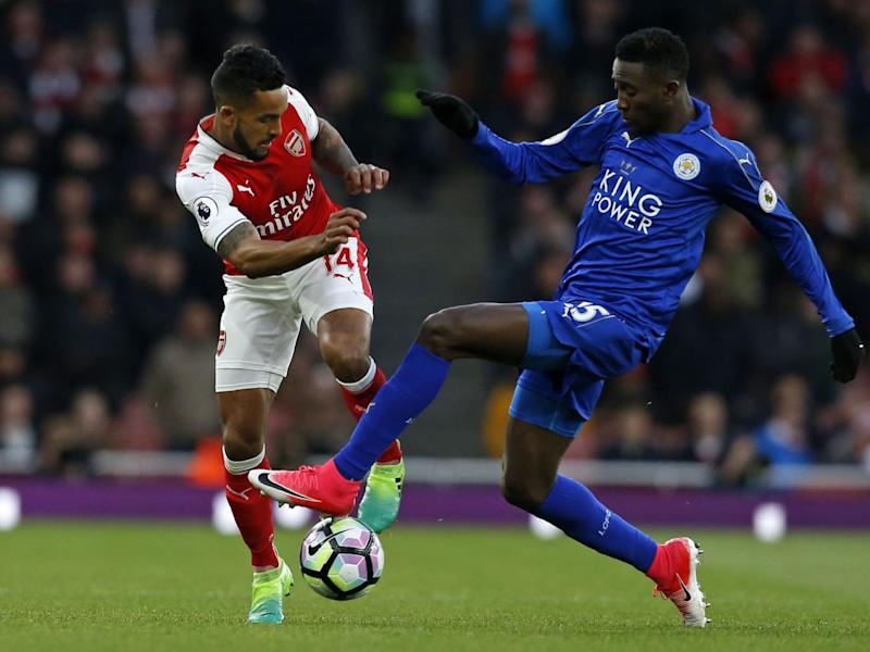 Wilfred Ndidi and Theo Walcott vie for possession (Getty)