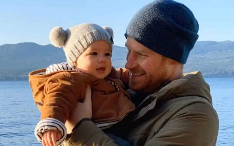 Prince Harry with Archie in Canada, in a picture shared for New Year - Sussex Royal
