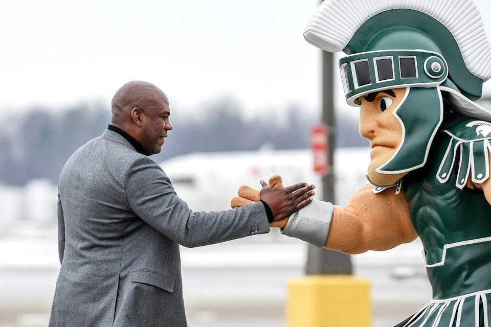 Sparty, right, will not be inside Spartan Stadium on Saturday for the Michigan State football debut of new coach Mel Tucker, left.
