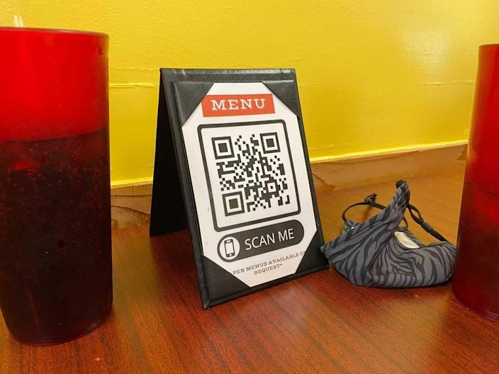 Many restaurants, including the Taqueria Becerra in Versailles, have switched to electronic menus that customers can view on their phones. This change was implemented during the COVID pandemic but is popular because it allows for easy updates.
