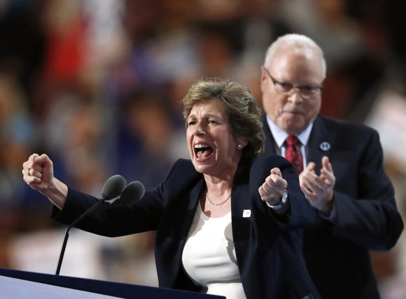 FILE - In this Monday, July 25, 2016, file photo, Randi Weingarten, president of American Federation of Teachers, speaks as Lee Saunders, president of American Federation of State, County and Municipal Employees, applauds during the first day of the Democratic National Convention in Philadelphia. Union membership among public employees has fallen only slightly in the nation's most unionized states since the Supreme Court ruled in 2018 that government workers no longer could be required to pay union fees, according to an analysis of federal data conducted for The Associated Press. (AP Photo/Paul Sancya, File)