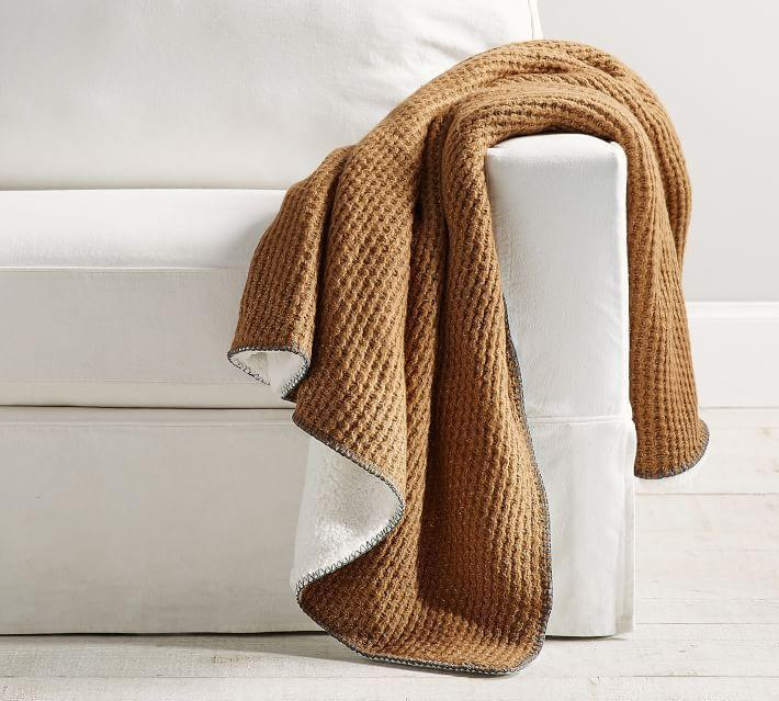 """<p>potterybarn.com</p><p><strong>$38.99</strong></p><p><a href=""""https://go.redirectingat.com?id=74968X1596630&url=https%3A%2F%2Fwww.potterybarn.com%2Fproducts%2Fthermal-knit-sherpa-back-throw&sref=https%3A%2F%2Fwww.menshealth.com%2Ftechnology-gear%2Fg35237975%2Flong-distance-relationship-gifts%2F"""" rel=""""nofollow noopener"""" target=""""_blank"""" data-ylk=""""slk:BUY IT HERE"""" class=""""link rapid-noclick-resp"""">BUY IT HERE</a></p><p>Lean into anything cozy for thoughtful long distance gifts. You're skipping out on a bunch of feel-good (and feel-safe) hormones. The most material thing you can substitute that with is a <em>very </em>comfy blanket. </p>"""