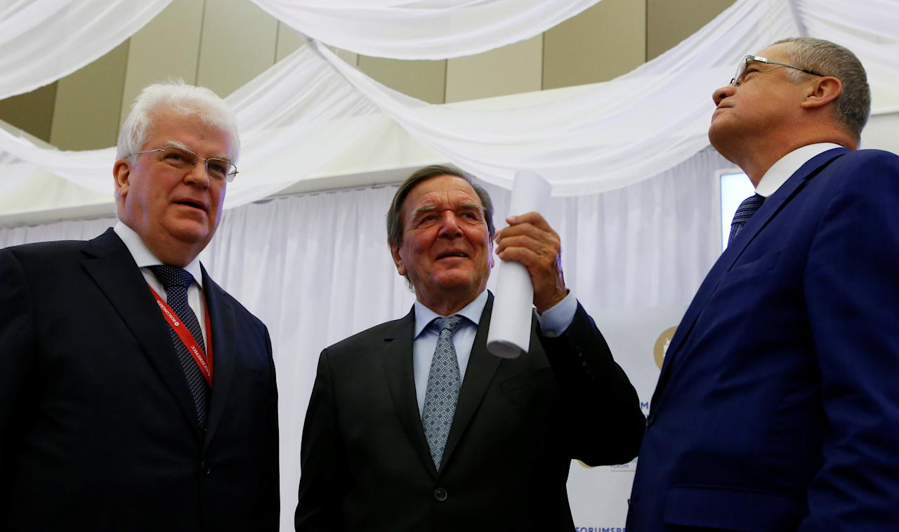 Vladimir Chizhov, Russian envoy to the European Union, Gerhard Schroeder, former German Chancellor and chairman of the shareholders' committee at Nord Stream AG, and Gazprom deputy chief executive Alexander Medvedev attend a working breakfast as part of the St. Petersburg International Economic Forum (SPIEF), Russia May 25, 2018. REUTERS/Sergei Karpukhin