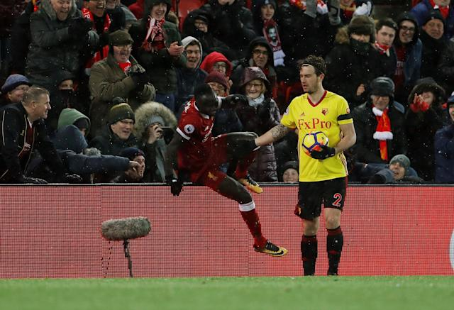 "Soccer Football - Premier League - Liverpool vs Watford - Anfield, Liverpool, Britain - March 17, 2018 Liverpool's Sadio Mane climbs out of the stands as Watford's Daryl Janmaat holds the ball Action Images via Reuters/Lee Smith EDITORIAL USE ONLY. No use with unauthorized audio, video, data, fixture lists, club/league logos or ""live"" services. Online in-match use limited to 75 images, no video emulation. No use in betting, games or single club/league/player publications. Please contact your account representative for further details."