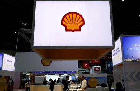 FILE PHOTO: Staff members work at the booth of Royal Dutch Shell at Gastech, the world's biggest expo for the gas industry, in Chiba, Japan, April 4, 2017.    REUTERS/Toru Hanai/File Photo