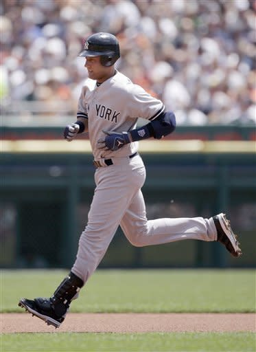New York Yankees' Derek Jeter rounds the bases after hitting a solo home run in the first inning of baseball game against the Detroit Tigers, Sunday, June 3, 2012, in Detroit. (AP Photo/Duane Burleson)