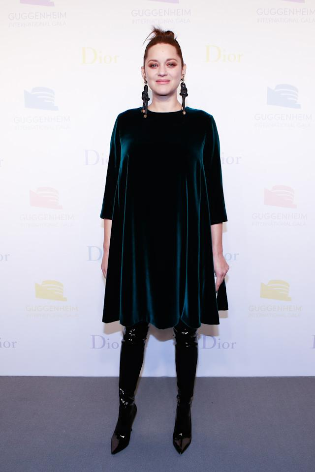 <p>Marion Cotillard turned out to the affair showing the girls just how to slay maternity style. The <em> Allied</em> actress paired a dark green silk velvet Dior dress with slick, high black boots and a clutch from the label. She finished off the look with statement rope earrings. </p>