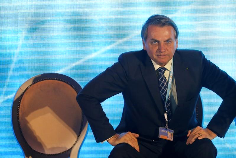 """Brazil's President Jair Bolsonaro attends the event """"Caixa Persons with disabilities"""" of Caixa Economica Federal Bank in Brasilia"""