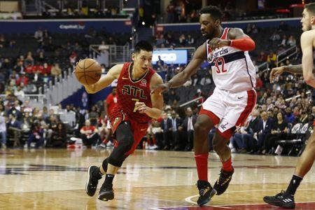 Feb 4, 2019; Washington, DC, USA; Atlanta Hawks guard Jeremy Lin (7) dribbles the ball as Washington Wizards forward Jeff Green (32) defends in the second quarter at Capital One Arena. Mandatory Credit: Geoff Burke-USA TODAY Sports