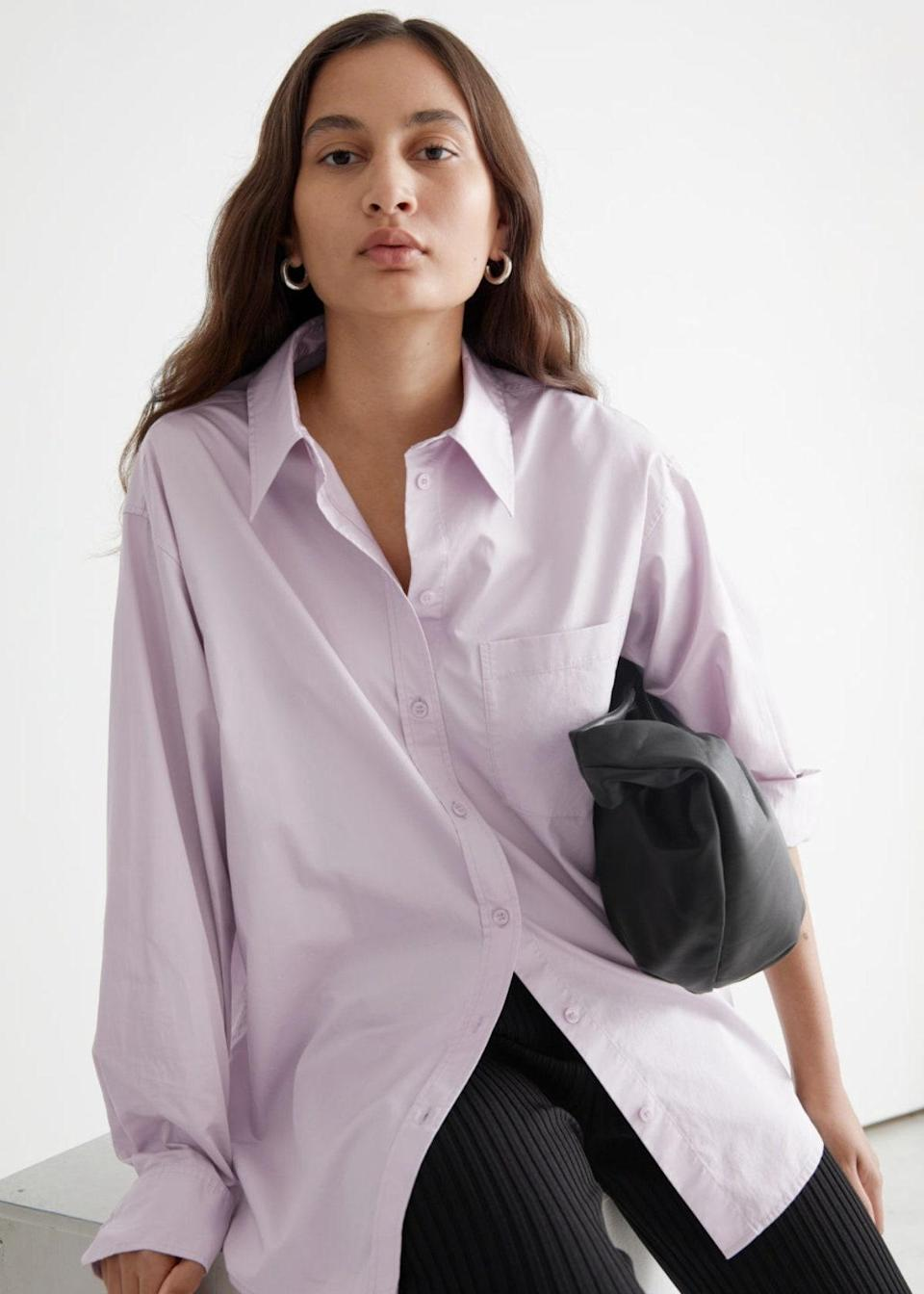 """Lilac plus black is the fall color palette you didn't know you needed…until now. $89, & Other Stories. <a href=""""https://www.stories.com/en_usd/clothing/blouses-shirts/shirts/product.voluminous-cotton-shirt-purple.0988078003.html"""" rel=""""nofollow noopener"""" target=""""_blank"""" data-ylk=""""slk:Get it now!"""" class=""""link rapid-noclick-resp"""">Get it now!</a>"""