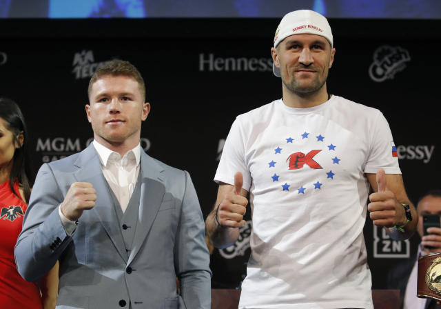 Canelo Alvarez (right) and Sergey Kovalev pose for photographers during a news conference Wednesday in Las Vegas. (AP Photo/John Locher)