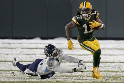 Green Bay Packers' Davante Adams runs past Tennessee Titans' Malcolm Butler during the second half of an NFL football game Sunday, Dec. 27, 2020, in Green Bay, Wis. (AP Photo/Morry Gash)