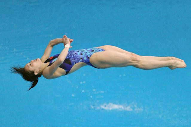 Wu Minxia of China competes in the Women's 3m Springboard Final during day two of the FINA/Midea Diving World Series 2012 Beijing Station at the National aquatics center on March 24, 2012 in Beijing, China.