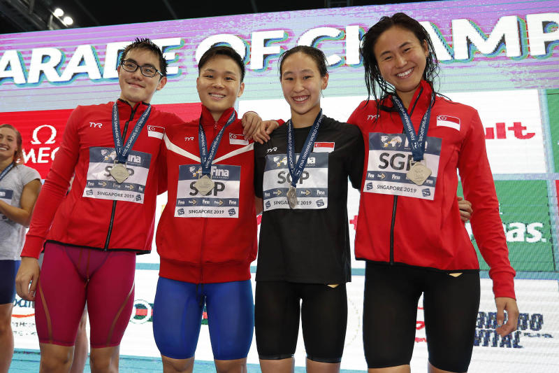 The silver-winning Singapore mixed 4x100m freestyle team at the Fina Swimming World Cup: (from left) Darren Chua, Pang Sheng Jun, Cherlyn Yeoh and Quah Ting Wen. (PHOTO: Singapore Swimming Association/Simone Castrovillari)