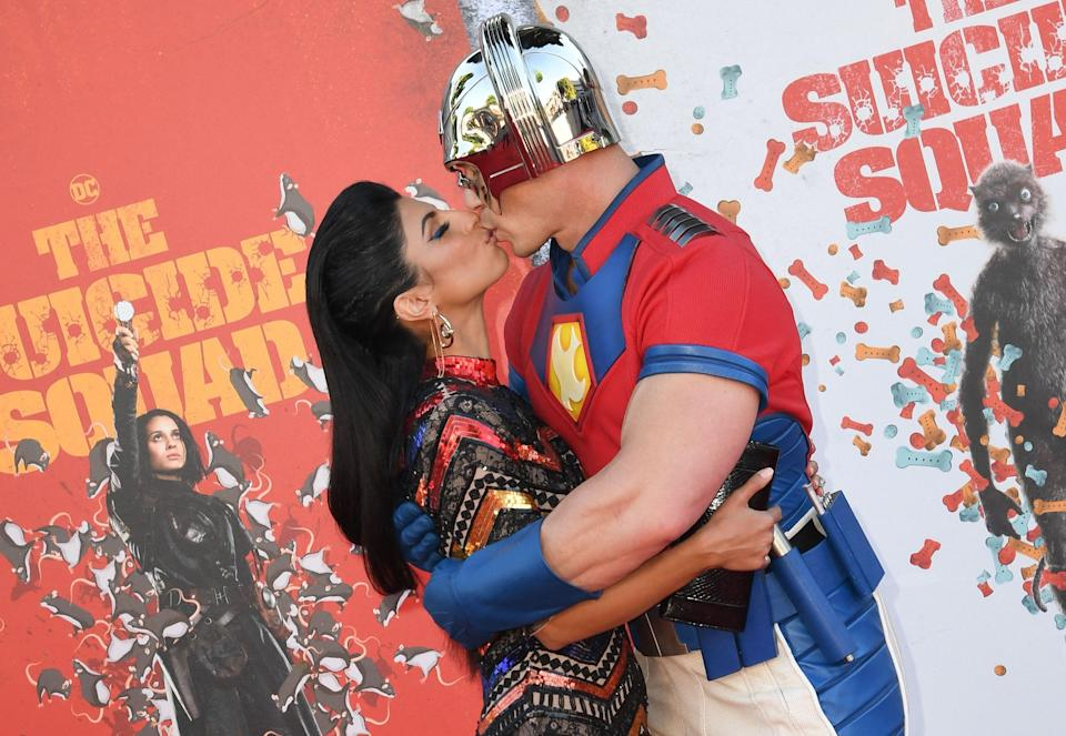 """John Cena and wife Shay Shariatzadeh kiss on the red carpet at the premiere of """"The Suicide Squad."""""""