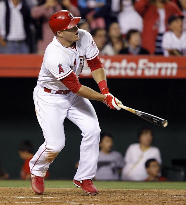 Los Angeles Angels' Mike Trout hits a grand slam home run against the Chicago White Sox in the eighth inning of a baseball game on Saturday, June 7, 2014 in Anaheim, Calif. (AP Photo/Alex Gallardo)