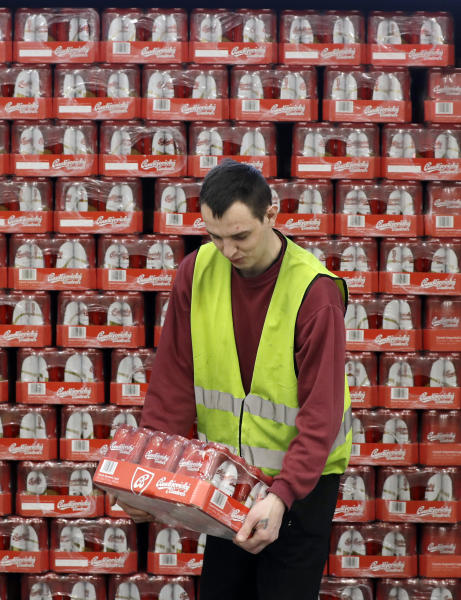 In this photo taken on Monday, March 11, 2019,a worker carries a case of beer at the Budejovicky Budvar brewery in Ceske Budejovice, Czech Republic. The Budejovicky Budvar brewery in the Czech Republic managed to survive a decades-long trademark battle over whether it could call its beer Budweiser. But now it faces another potential threat: Brexit. The United Kingdom is one of the brewer's top five markets, and like many other businesses, it's concerned about what will happen if Britain leaves the European Union without an agreement governing trade. (AP Photo/Petr David Josek)