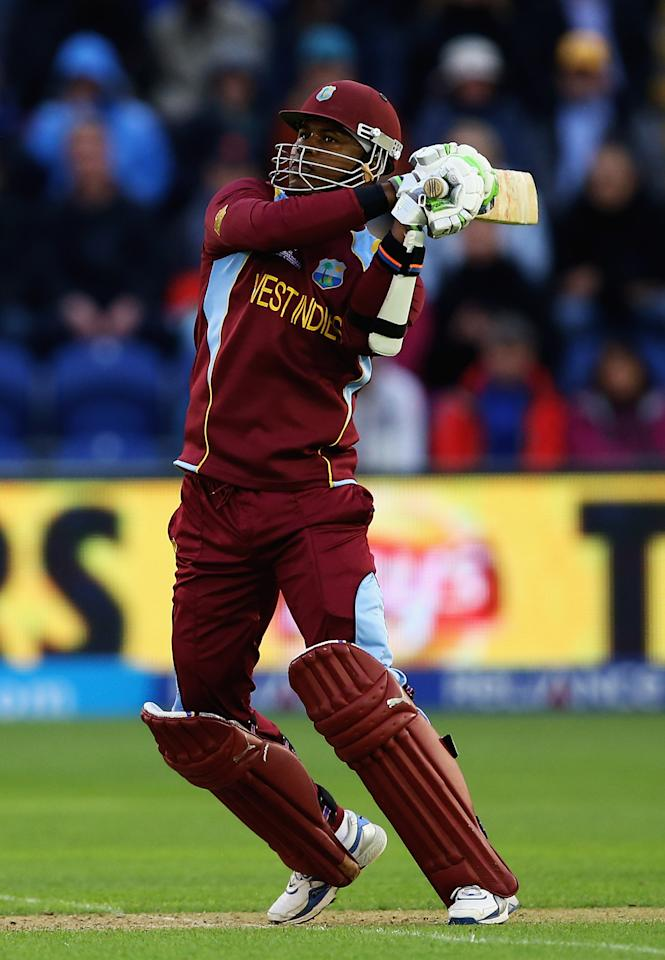CARDIFF, WALES - JUNE 14:  Marlon Samuels of the West Indies hits the ball towards the boundary during the ICC Champions Trophy Group B match between West Indies and South Africa at SWALEC Stadium on June 14, 2013 in Cardiff, Wales.  (Photo by Matthew Lewis-ICC/ICC via Getty Images)