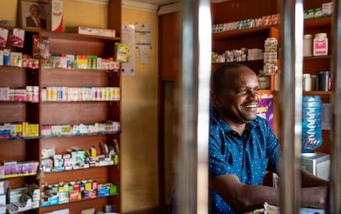 Patrick Ngore, 36, poses for a portrait in his Chemist store in Wangige Town, Kiambu County, Kenya - Credit: Katie G. Nelson/The Telegraph