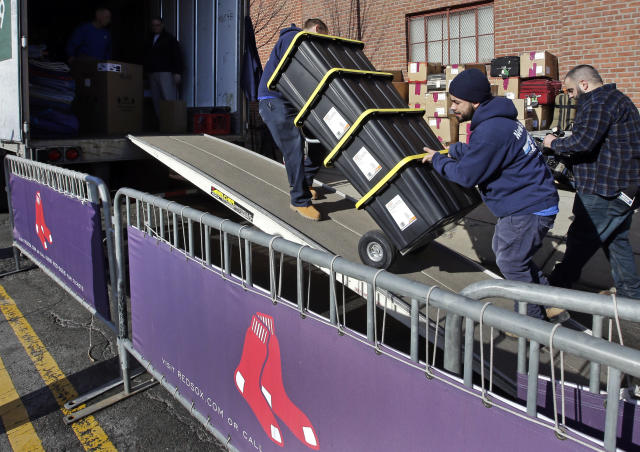 Workers load a case onto the Boston Red Sox baseball team's truck outside Fenway Park, Monday, Feb. 4, 2019, in Boston. The truck will be heading to JetBlue Park in Fort Myers, Fla. for the players' spring training. (AP Photo/Steven Senne)