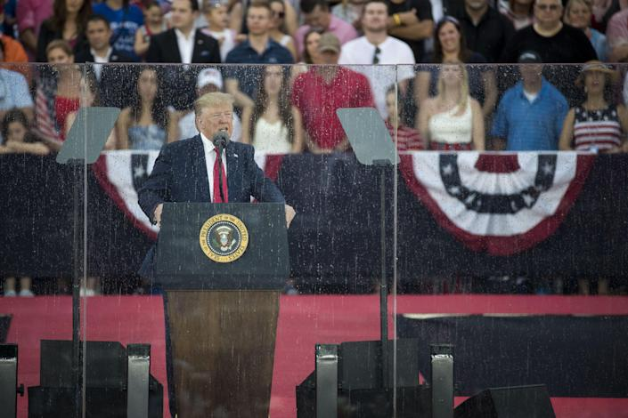"""President Donald Trump delivers remarks at the """"Salute to America"""" ceremony in front of the Lincoln Memorial, on July 4, 2019 in Washington, DC. The presentation features armored vehicles on display, a flyover by Air Force One, and several flyovers by other military aircraft."""