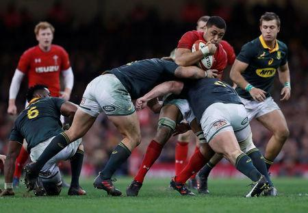 Rugby Union - Autumn Internationals - Wales vs South Africa - Principality Stadium, Cardiff, Britain - December 2, 2017 Wales' Taulupe Faletau in action with South Africa's Malcolm Marx and Wilco Louw Action Images via Reuters/Andrew Boyers