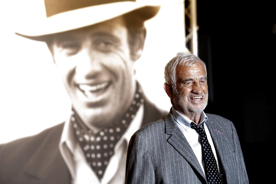 FILE - In this Oct. 14, 2013 file photo, French actor Jean-Paul Belmondo poses for photographers as he arrives at the opening ceremony of the 5th edition of the Lumiere Festival, in Lyon, central France. French New Wave actor Jean-Paul Belmondo has died, according to his lawyer's office on Monday Sept. 6, 2021. (AP Photo/Laurent Cipriani, File)