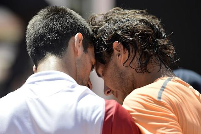 TOPSHOTS Spanish Rafael Nadal (R) is congratulated by Serbian Novak Djokovic at the end of the final of the AFP Rome Tennis masters on May 21, 2012. Nadal defeated Serbian Novak Djokovic 7-5, 6-3 to win the tournament. AFP PHOTO / FILIPPO MONTEFORTEFILIPPO MONTEFORTE/AFP/GettyImages