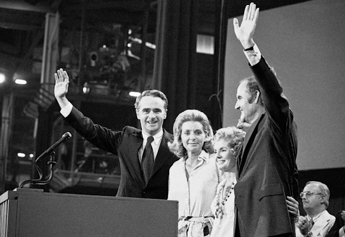 FILE - In this July 14, 1972 file photo, Sen. George S. McGovern with his wife, Eleanor, and Sen. Thomas F. Eagleton with his wife, Barbara Ann, stand before the Democratic National Convention delegates who chose them to try to capture the White House from President Richard Nixon in Miami. A family spokesman says, McGovern, the Democrat who lost to President Richard Nixon in 1972 in a historic landslide, has died at the age of 90. According to the spokesman, McGovern died Sunday, Oct. 21, 2012 at a hospice in Sioux Falls, surrounded by family and friends. (AP Photo)