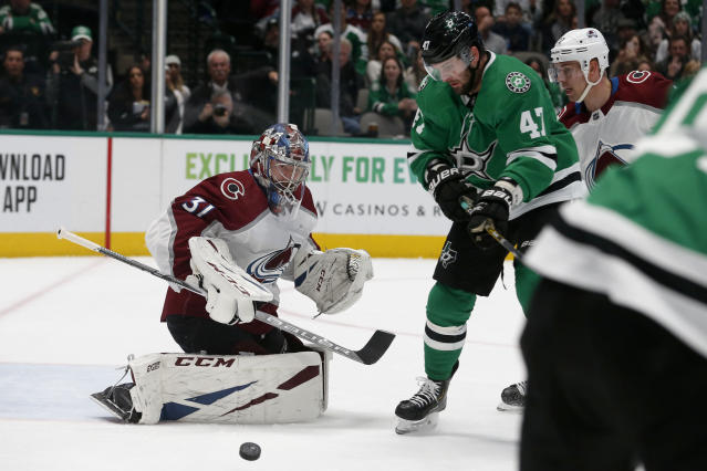 Dallas Stars right wing Alexander Radulov (47) watches as a shot deflects off the pad of Colorado Avalanche goaltender Philipp Grubauer (31) during the first period of an NHL hockey game in Dallas, Saturday, Dec. 28, 2019. (AP Photo/Michael Ainsworth)