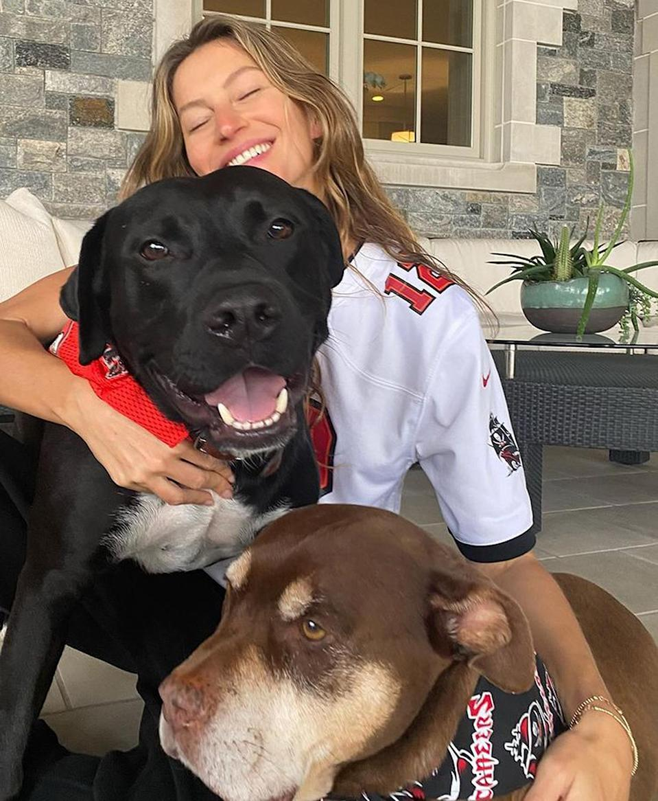 """<p>The supermodel's new Buccaneers fandom is obvious: she's married to the quarterback! <a href=""""https://people.com/tag/tom-brady/"""" rel=""""nofollow noopener"""" target=""""_blank"""" data-ylk=""""slk:Tom Brady"""" class=""""link rapid-noclick-resp"""">Tom Brady</a> left the New England Patriots after two decades last year, joining the Buccaneers and moving Bündchen and their family to Tampa.</p>"""