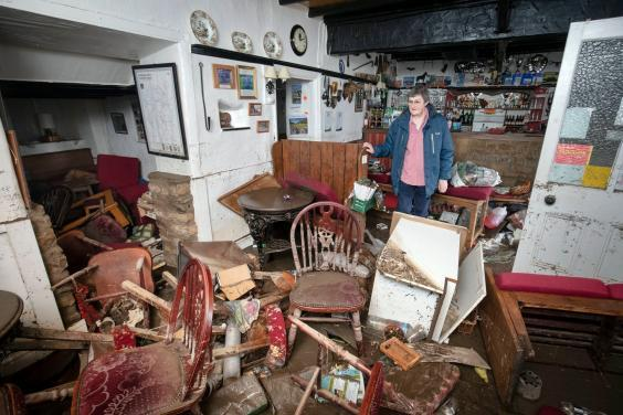 Rowena Hutchinson in her pub, the Red Lion Inn, which was devastated by flooding in Langthwaite, North Yorkshire (PA)