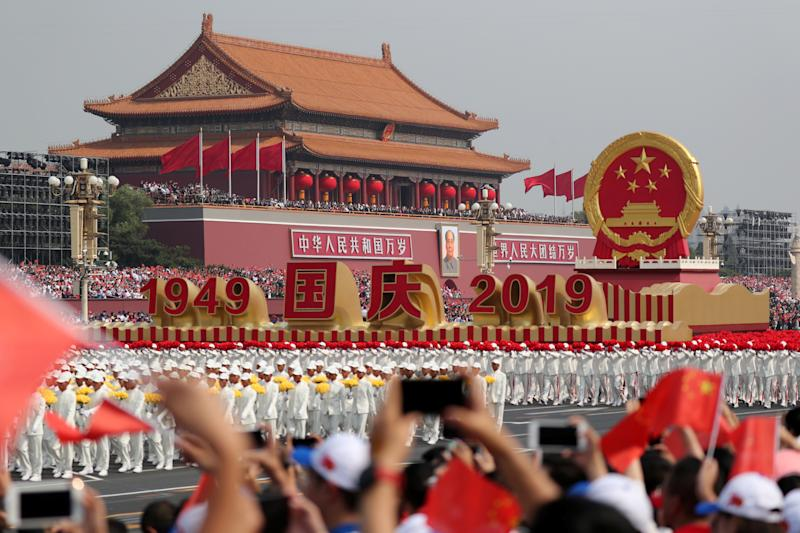 A float featuring Chinaís national emblem travels past Tianíanmen Gate during a parade marking the 70th anniversary of the founding of the People's Republic of China, on its National Day in Beijing, China October 1, 2019. (Photo: China Daily via Reuters)