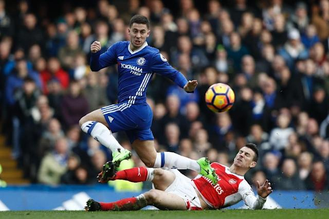 Arsenal's Laurent Koscielny (R) cuts out a through ball intended for Chelsea's Eden Hazard during their English Premier League match, at Stamford Bridge in London, on February 4, 2017 (AFP Photo/Adrian Dennis)