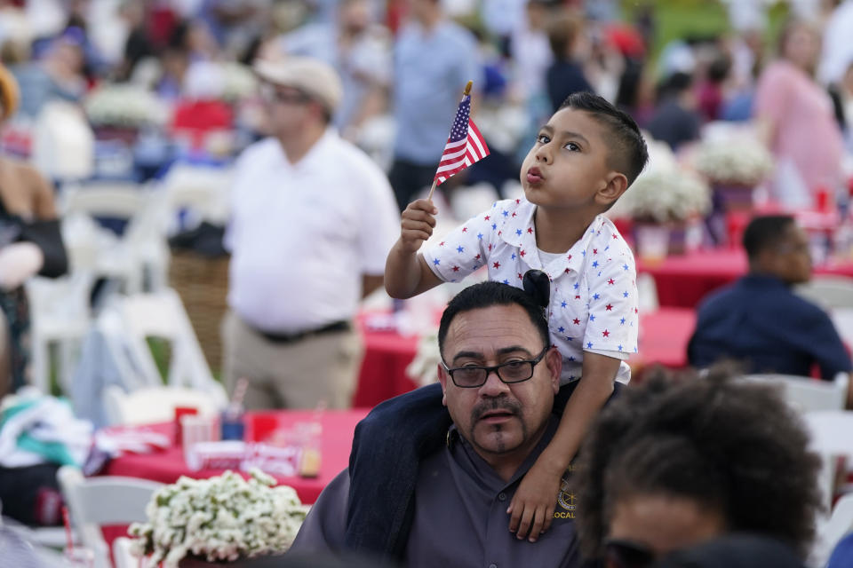 Attendees wait to hear President Joe Biden speak during an Independence Day celebration on the South Lawn of the White House, Sunday, July 4, 2021, in Washington. (AP Photo/Patrick Semansky)