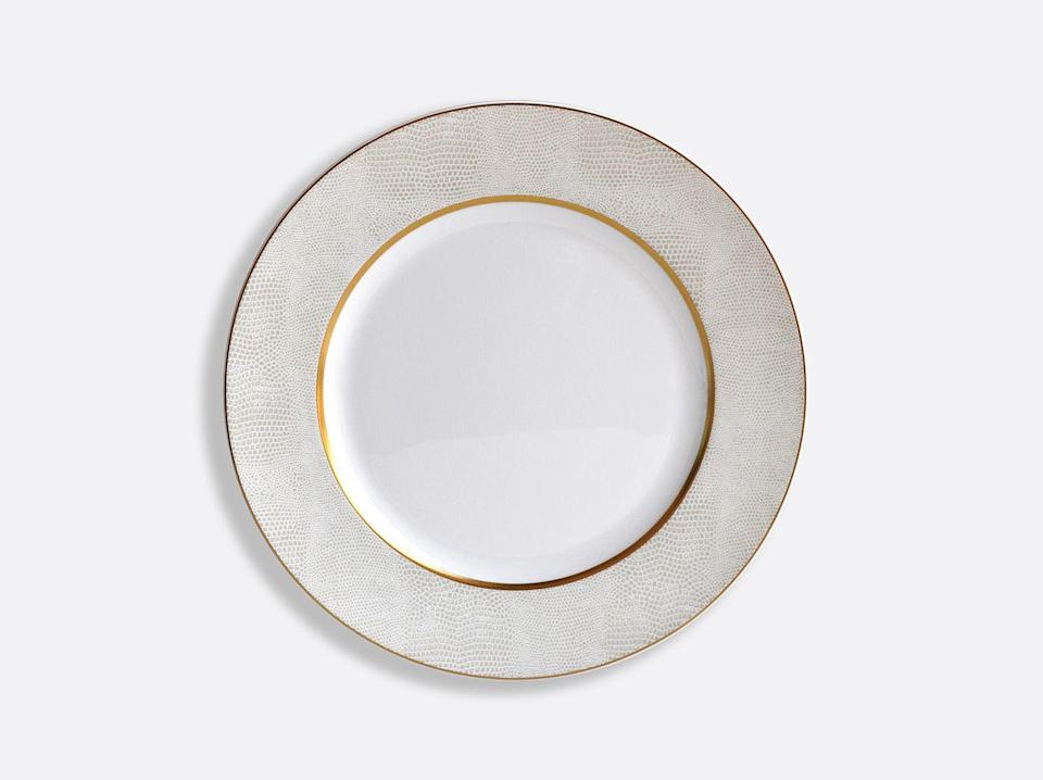 """<p><strong>Bernardaud</strong></p><p>bernardaud.com</p><p><strong>$59.00</strong></p><p><a href=""""https://www.bernardaud.com/en/us/sauvage-or/sauvage-or-dinner-plate-10-5"""" rel=""""nofollow noopener"""" target=""""_blank"""" data-ylk=""""slk:Discover"""" class=""""link rapid-noclick-resp"""">Discover</a></p><p>A shagreen-like design on these chic silver-and-gold dinner plates will make your New Year's Eve dinner party an even more sophisticated scene. </p>"""