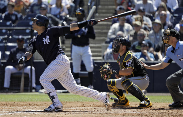 New York Yankees' Gary Sanchez follows through on his three-run home run off Pittsburgh Pirates' Brett McKinney during the third inning of a spring training baseball game Thursday, March 15, 2018, in Tampa, Fla. Yankees' Aaron Judge, and Giancarlo Stanton scored. Catching for the Pirates is Francisco Cervelli. (AP Photo/Chris O'Meara)
