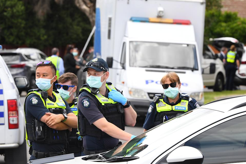 Victoria Police work at a crime scene in Tullamarine, Melbourne.
