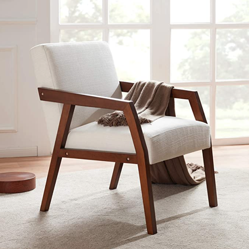 """<h3>Mid-Century Modern Accent Chair</h3><br>Turn your cozy reading nook dreams into an achievable reality with this under-$200 Scandi-style accent chair. <br><br><strong>HUIMO</strong> Wooden Mid-Century Modern Accent Chair, $, available at <a href=""""https://amzn.to/2Wabpo5"""" rel=""""nofollow noopener"""" target=""""_blank"""" data-ylk=""""slk:Amazon"""" class=""""link rapid-noclick-resp"""">Amazon</a>"""