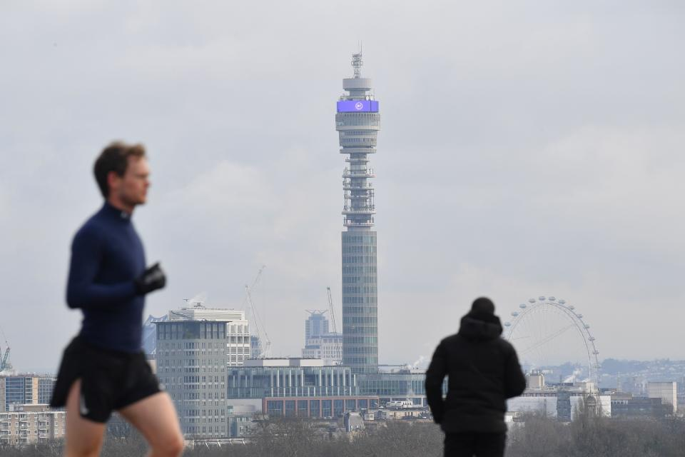 A jogger runs in Primrose Hill park with the BT Tower on the skyline in London on January 12, 2021 as life continues under Britain's third lockdown since the start of the coronavirus pandemic. - People who flout coronavirus lockdown rules are putting lives at risk, the British government said on Tuesday, as cases surge to record highs and rumours swirl of potentially tougher restrictions. (Photo by JUSTIN TALLIS / AFP) (Photo by JUSTIN TALLIS/AFP via Getty Images)